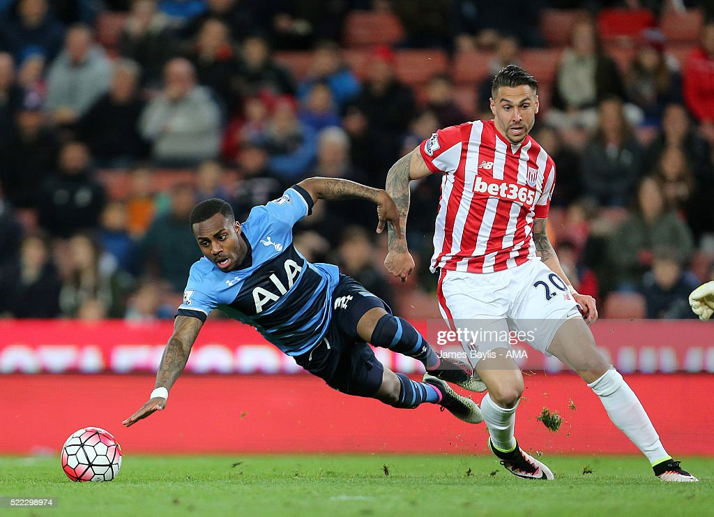 Danny Rose of Tottenham Hotspur and Geoff Cameron of Stoke City during the Barclays Premier League match between Stoke City and Tottenham Hotspur at...