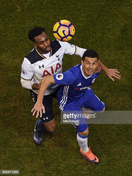 Danny Rose of Tottenham Hotspur and Pedro of Chelsea battle to win a header during the Premier League match between Tottenham Hotspur and Chelsea at...