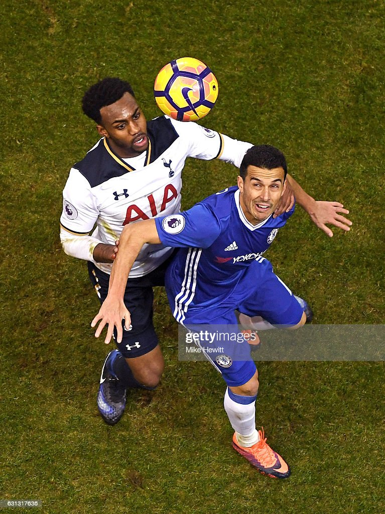 Danny Rose of Tottenham Hotspur (L) and Pedro of Chelsea (R) battle to win a header during the Premier League match between Tottenham Hotspur and Chelsea at White Hart Lane on January 4, 2017 in London, England.
