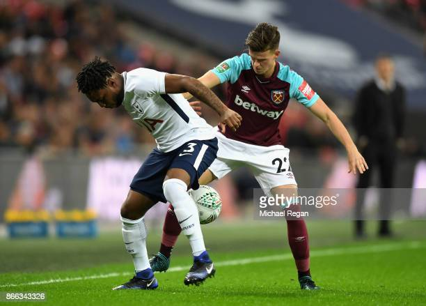 Danny Rose of Tottenham Hotspur and Sam Byram of West Ham United battle for the ball during the Carabao Cup Fourth Round match between Tottenham...