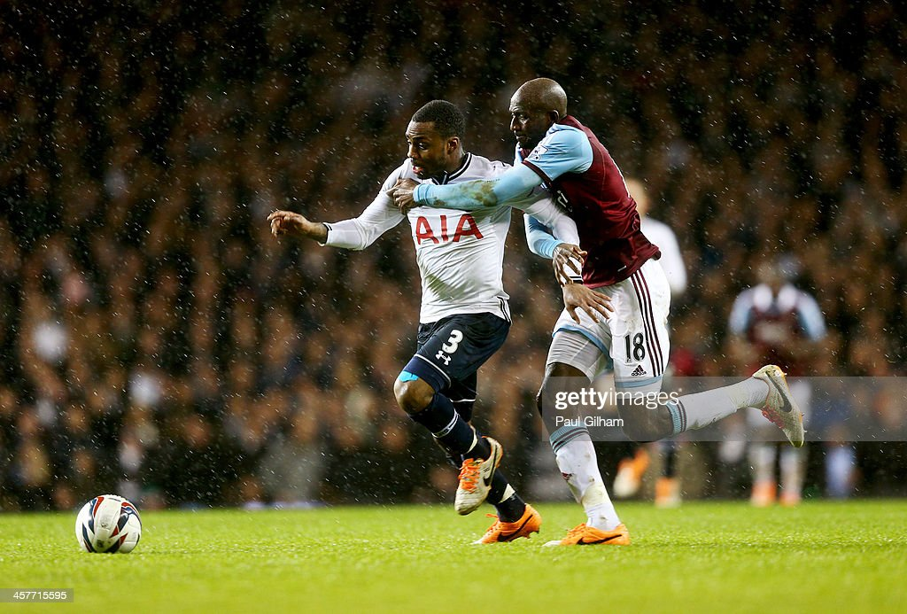 Danny Rose of Tottenham Hotspur battles with <a gi-track='captionPersonalityLinkClicked' href=/galleries/search?phrase=Alou+Diarra&family=editorial&specificpeople=465019 ng-click='$event.stopPropagation()'>Alou Diarra</a> of West Ham United during the Capital One Cup Quarter-Final match between Tottenham Hotspur and West Ham United at White Hart Lane on December 18, 2013 in London, England.