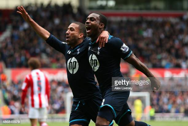 Danny Rose of Tottenham Hotspur celebrates with Aaron Lennon after scoring the opening goal during the Barclays Premier League match between Stoke...