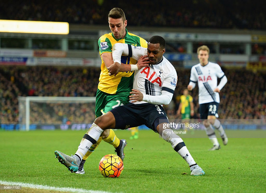 Danny Rose of Tottenham Hotspur controls the ball under pressure of Ivo Pinto of Norwich City during the Barclays Premier League match between...