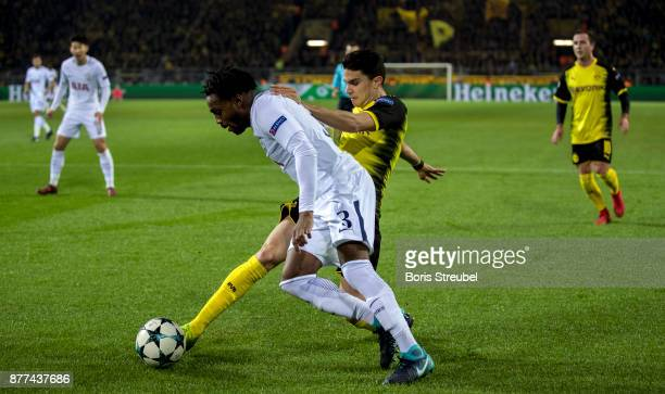 Danny Rose of Tottenham Hotspur is challenged by Marc Bartra of Borussia Dortmund during the UEFA Champions League group H match between Borussia...