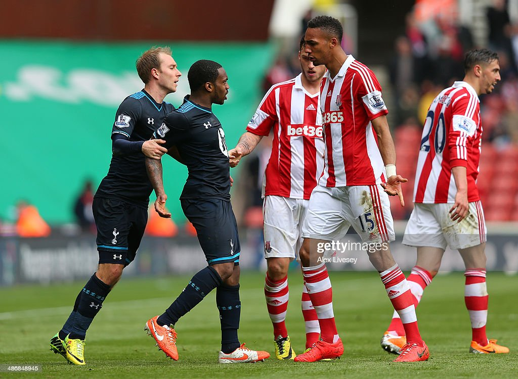 Danny Rose of Tottenham Hotspur is held back by <a gi-track='captionPersonalityLinkClicked' href=/galleries/search?phrase=Christian+Eriksen&family=editorial&specificpeople=6757192 ng-click='$event.stopPropagation()'>Christian Eriksen</a> after clashing with <a gi-track='captionPersonalityLinkClicked' href=/galleries/search?phrase=Geoff+Cameron&family=editorial&specificpeople=5101639 ng-click='$event.stopPropagation()'>Geoff Cameron</a> and Steven Nzonzi of Stoke City during the Barclays Premier League match between Stoke City and Tottenham Hotspur at the Britannia Stadium on April 26, 2014 in Stoke on Trent, England.