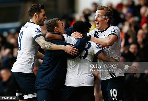 Danny Rose of Tottenham Hotspur is mobbed by team mates including Harry Kane of Tottenham Hotspur after scoring his team's second goal during the...