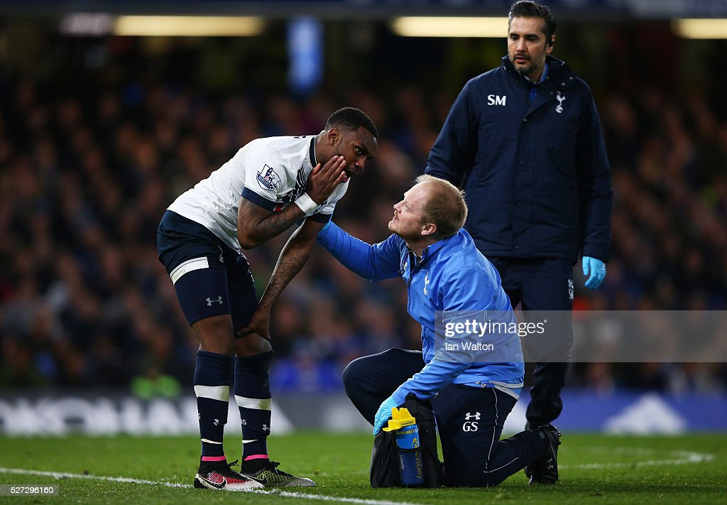Danny Rose of Tottenham Hotspur receives treatment during the Barclays Premier League match between Chelsea and Tottenham Hotspur at Stamford Bridge on May 02, 2016 in London, England.