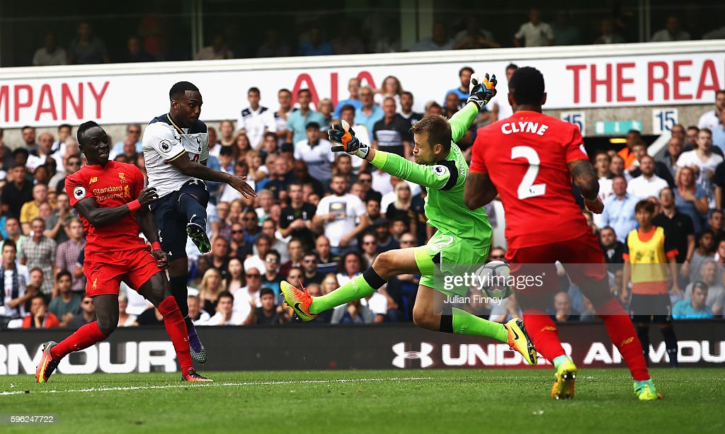Danny Rose of Tottenham Hotspur scores his sides first goal past Simon Mignolet of Liverpool during the Premier League match between Tottenham...