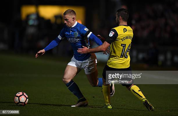 Danny Rowe of Macclesfield Town is tackled by Joe Rothwell of Oxford during The Emirates FA Cup Second Round match between Macclesfield Town and...