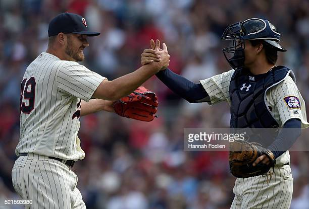 Danny Santana and John Ryan Murphy of the Minnesota Twins celebrate a win of the game against the Los Angeles Angels of Anaheim on April 16 2016 at...