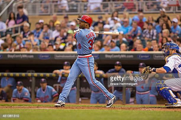 Danny Santana of the Minnesota Twins bats against the Milwaukee Brewers on June 5 2014 at Target Field in Minneapolis Minnesota The Brewers defeated...