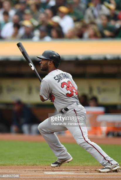 Danny Santana of the Minnesota Twins bats against the Oakland Athletics in the top of the first inning at Oco Coliseum on August 9 2014 in Oakland...