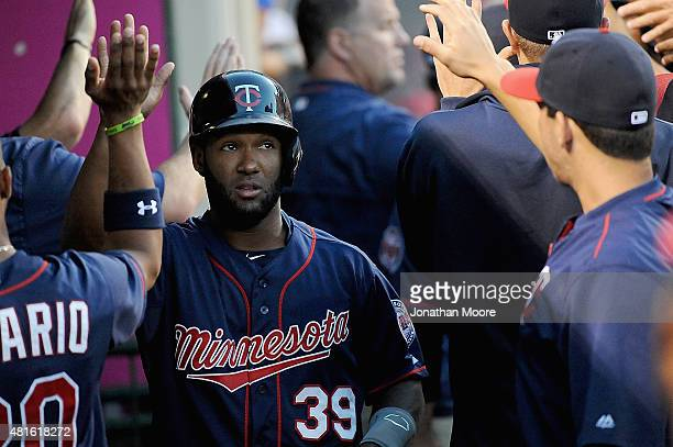 Danny Santana of the Minnesota Twins celebrates after scoring on a two run single hit by Brian Dozier in the third inning during a game against the...
