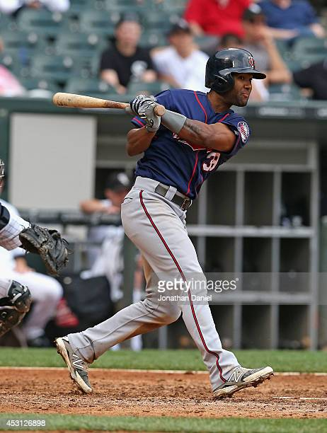 Danny Santana of the Minnesota Twins hits a runscoring triple in the 8th inning against the Chicago White Sox at US Cellular Field on August 3 2014...