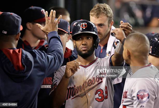 Danny Santana of the Minnesota Twins is congratulated after scoring on a single by Kurt Suzuki during the sixth inning of a game against the Detroit...