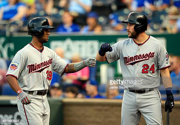Danny Santana of the Minnesota Twins is congratulated by Trevor Plouffe after hitting a leadoff solo home run during the 1st inning of the game...