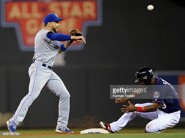 Danny Santana of the Minnesota Twins is out at second base as Omar Infante of the Kansas City Royals attempts to turn a double play during the sixth...
