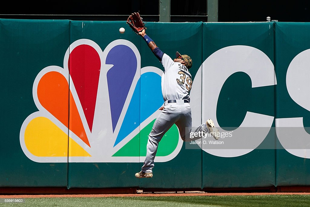<a gi-track='captionPersonalityLinkClicked' href=/galleries/search?phrase=Danny+Santana&family=editorial&specificpeople=6602314 ng-click='$event.stopPropagation()'>Danny Santana</a> #39 of the Minnesota Twins leaps for but is unable to catch a fly ball hit off the bat of Stephen Vogt (not pictured) of the Oakland Athletics for a double during the sixth inning at the Oakland Coliseum on May 30, 2016 in Oakland, California. The Oakland Athletics defeated the Minnesota Twins 3-2.