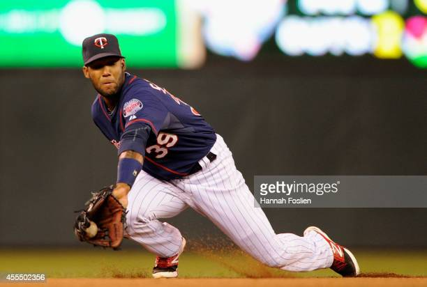 Danny Santana of the Minnesota Twins makes a play at shortstop to stop the ball hit by Ian Kinsler of the Detroit Tigers during the second inning of...
