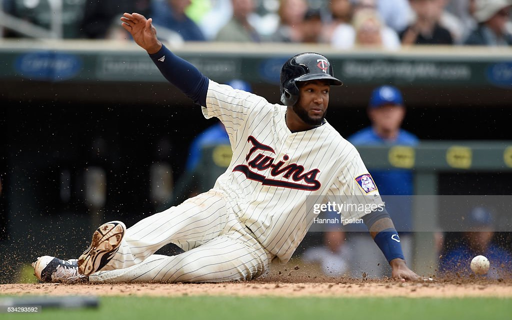 <a gi-track='captionPersonalityLinkClicked' href=/galleries/search?phrase=Danny+Santana&family=editorial&specificpeople=6602314 ng-click='$event.stopPropagation()'>Danny Santana</a> #39 of the Minnesota Twins slides safely into home plate as the ball gets past Drew Butera #9 of the Kansas City Royals during the fourth inning of the game on May 25, 2016 at Target Field in Minneapolis, Minnesota. The Twins defeated the Royals 7-5.