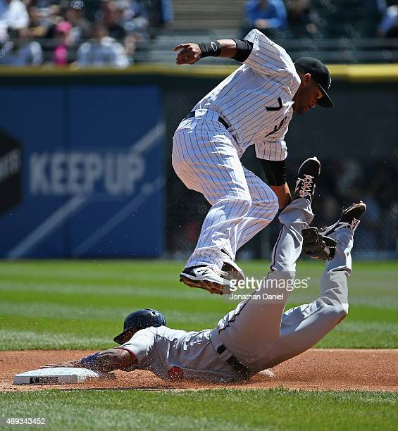 Danny Santana of the Minnesota Twins steals second base as Micah Johnson of the Chicago White Sox leaps to try and make the tag in the 1st inning at...