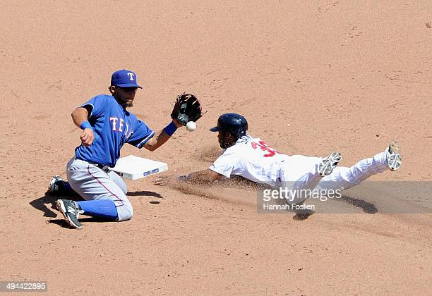 Danny Santana of the Minnesota Twins steals second base as Rougned Odor of the Texas Rangers fields the ball during the sixth inning of the game on...