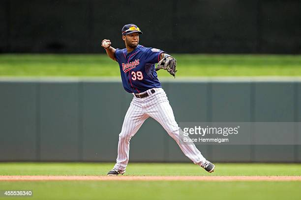Danny Santana of the Minnesota Twins throws against the Cleveland Indians on August 21 2014 at Target Field in Minneapolis Minnesota The Twins...