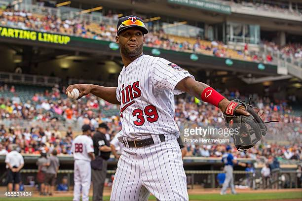 Danny Santana of the Minnesota Twins throws against the Kansas City Royals on August 17 2014 at Target Field in Minneapolis Minnesota The Royals...