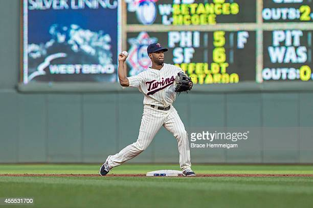 Danny Santana of the Minnesota Twins throws against the Kansas City Royals on August 16 2014 at Target Field in Minneapolis Minnesota The Twins...