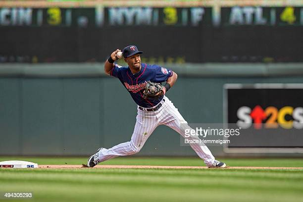Danny Santana of the Minnesota Twins throws against the Seattle Mariners on May 18 2014 at Target Field in Minneapolis Minnesota The Mariners...