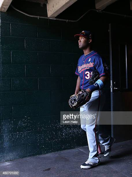 Danny Santana of the Minnesota Twins walks fom the clubhouse to the dugout prior to the start of the game against the Detroit Tigers at Comerica Park...