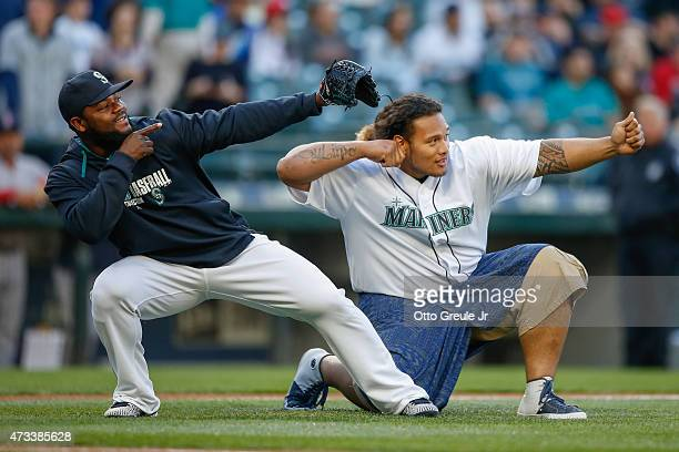 Danny Shelton newly selected draft pick of the Cleveland Browns strikes the celebratory arrow pose with closing pitcher Fernando Rodney of the...