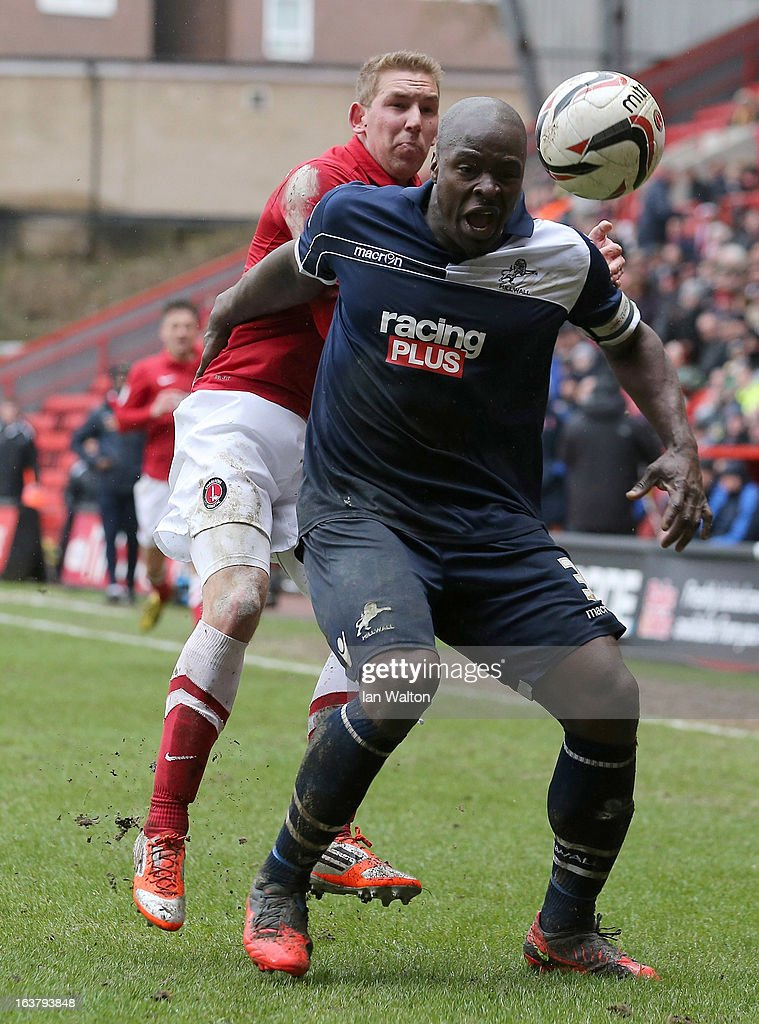 Danny Shittu (R) of Millwall and Scott Wagstaff of Charlton Athletic in action during the npower Championship match between Charlton Athletic and Millwall at The Valley on March 16, 2013 in London, England.