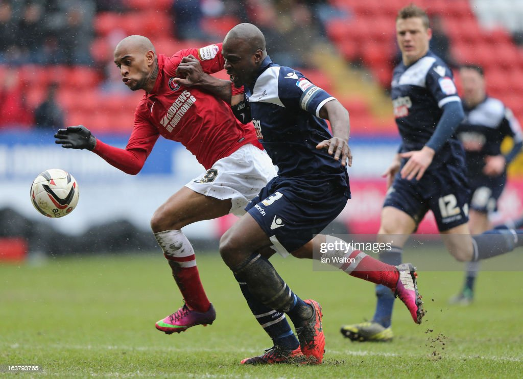 Danny Shittu (R) of Millwall tries to tackle Danny Haynes of Charlton Athletic during the npower Championship match between Charlton Athletic and Millwall at The Valley on March 16, 2013 in London, England.