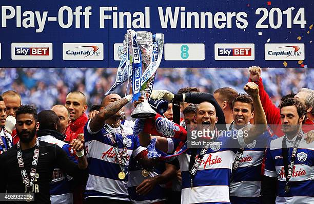 Danny Simpson Bobby Zamora and the QPR team celebrate with the trophy after their victory in the Sky Bet Championship Playoff Final match between...