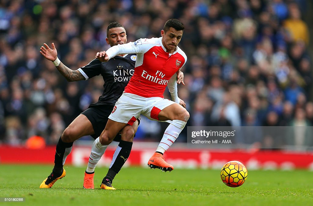 Danny Simpson of Leicester City and Alexis Sanchez of Arsenal during the Barclays Premier League match between Arsenal and Leicester City at the Emirates Stadium on February 14, 2016 in London, England.