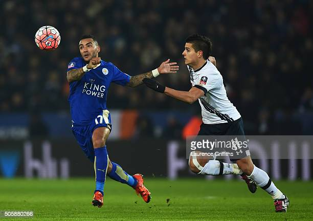 Danny Simpson of Leicester City and Erik Lamela of Spurs compete for the ball during the Emirates FA Cup Third Round Replay match between Leicester...