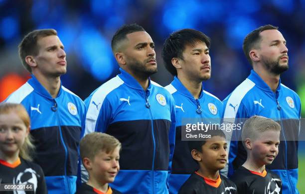 Danny Simpson of Leicester City and Shinji Okazaki of Leicester City line up prior to the UEFA Champions League Quarter Final second leg match...