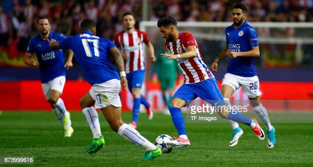 Danny Simpson of Leicester City and Yannick Carrasco of Atletico Madrid battle for the ball during the UEFA Champions League Quarter Final first leg...