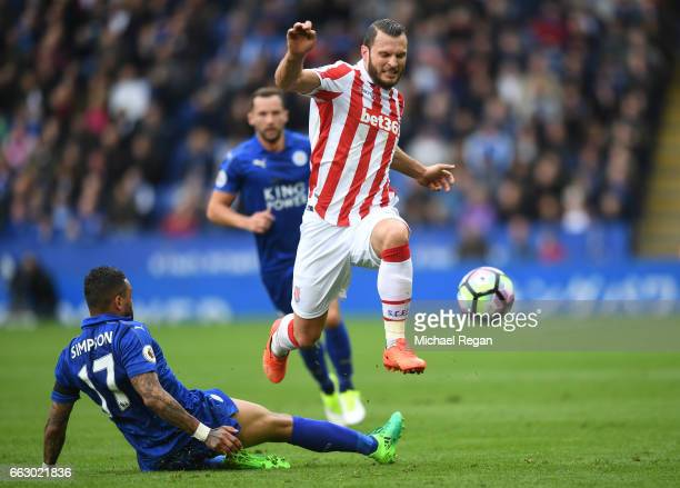 Danny Simpson of Leicester City attempts to tackle Erik Pieters of Stoke City during the Premier League match between Leicester City and Stoke City...