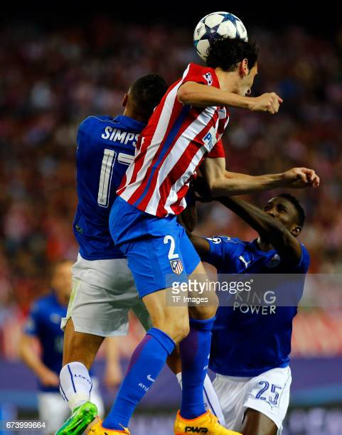 Danny Simpson of Leicester City Diego Godin of Atletico Madrid and Onyinye Ndidi of Leicester City battle for the ball during the UEFA Champions...