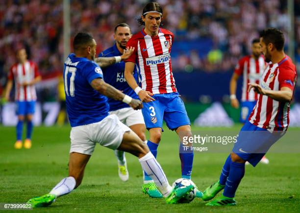 Danny Simpson of Leicester City Filipe Luis of Atletico Madrid and Yannick Carrasco of Atletico Madrid battle for the ball during the UEFA Champions...