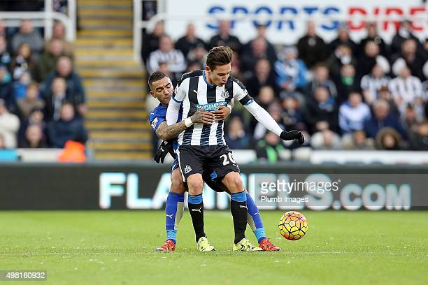 Danny Simpson of Leicester City gets to grips with Florian Thauvin of Newcastle United the Premier League match between Newcastle United and...