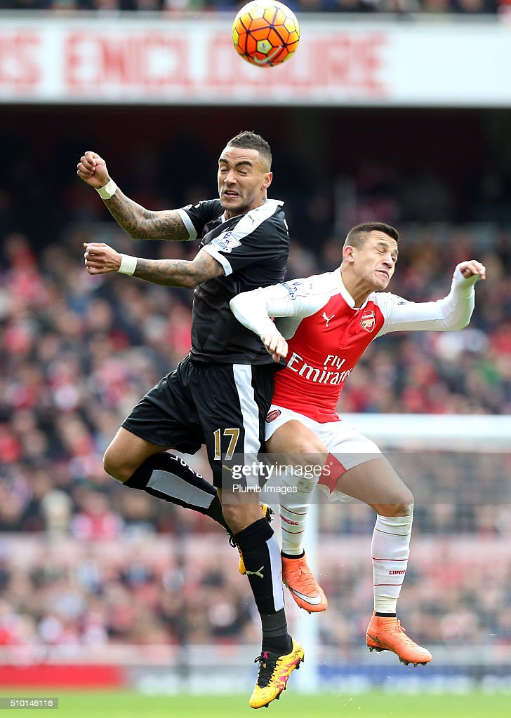 Danny Simpson of Leicester City in action with Alexis Sanchez of Arsenal during the Premier League match between Arsenal and Leicester City at Emirates Stadium on February 14, 2016 in London, United Kingdom.