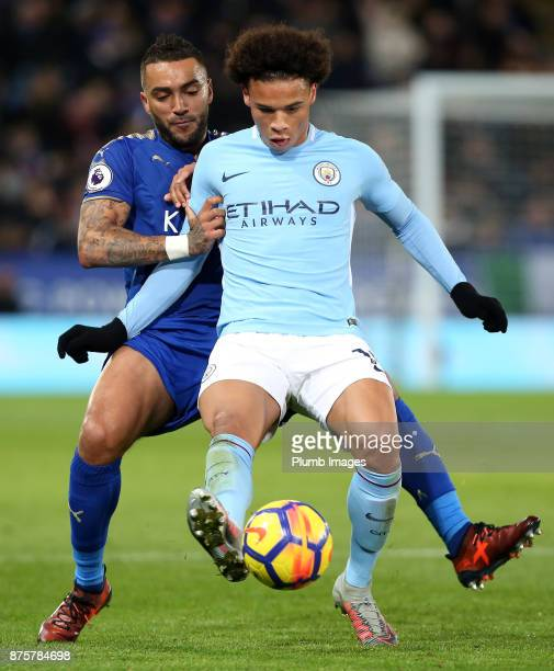 Danny Simpson of Leicester City in action with Leroy Sane of Manchester City during the Premier League match between Leicester City and Manchester...