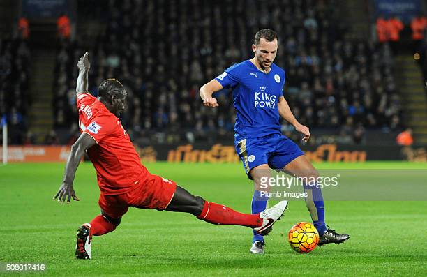 Danny Simpson of Leicester City in action with Mamadou Sakho of Liverpool during the Barclays Premier League match between Leicester City and...