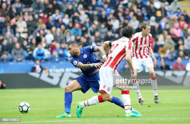 Danny Simpson of Leicester City in action with Ramadan Sobhi of Stoke City during the Premier League match between Leicester City and Stoke City at...