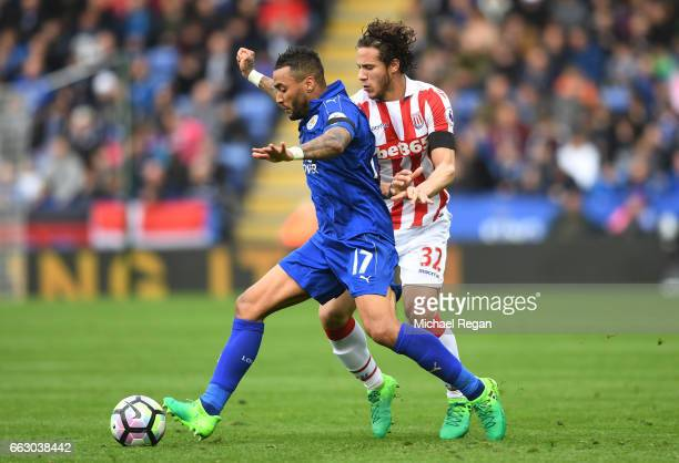Danny Simpson of Leicester City is put under pressure from Ramadan Sobhi of Stoke City during the Premier League match between Leicester City and...
