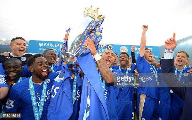 Danny Simpson of Leicester City lifts the Premier League Trophy as players celebrate the season champions after the Barclays Premier League match...