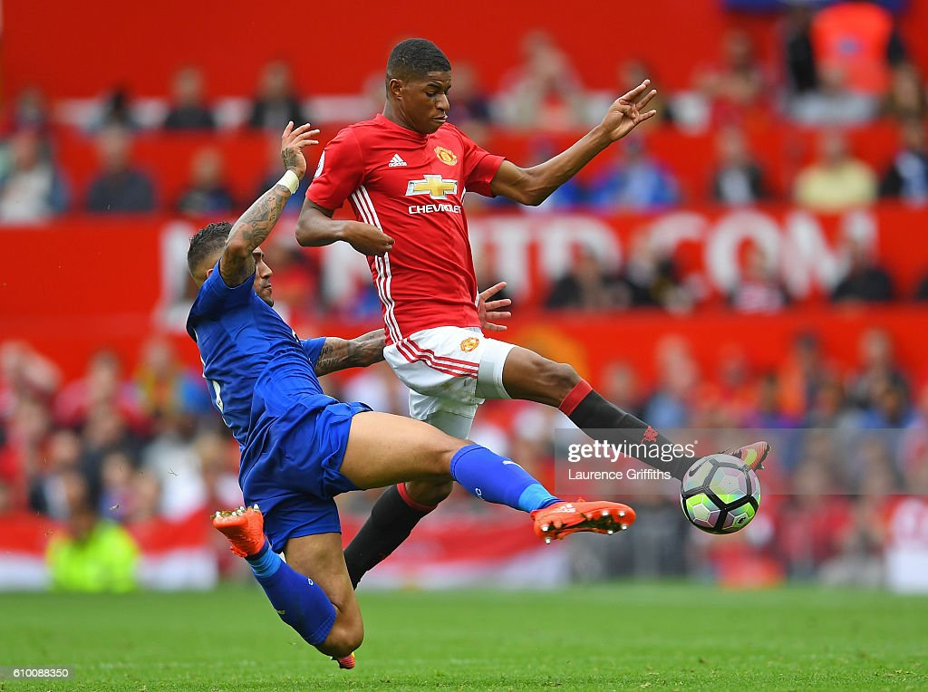Danny Simpson of Leicester City (L) tackles Marcus Rashford of Manchester United (R) during the Premier League match between Manchester United and Leicester City at Old Trafford on September 24, 2016 in Manchester, England.